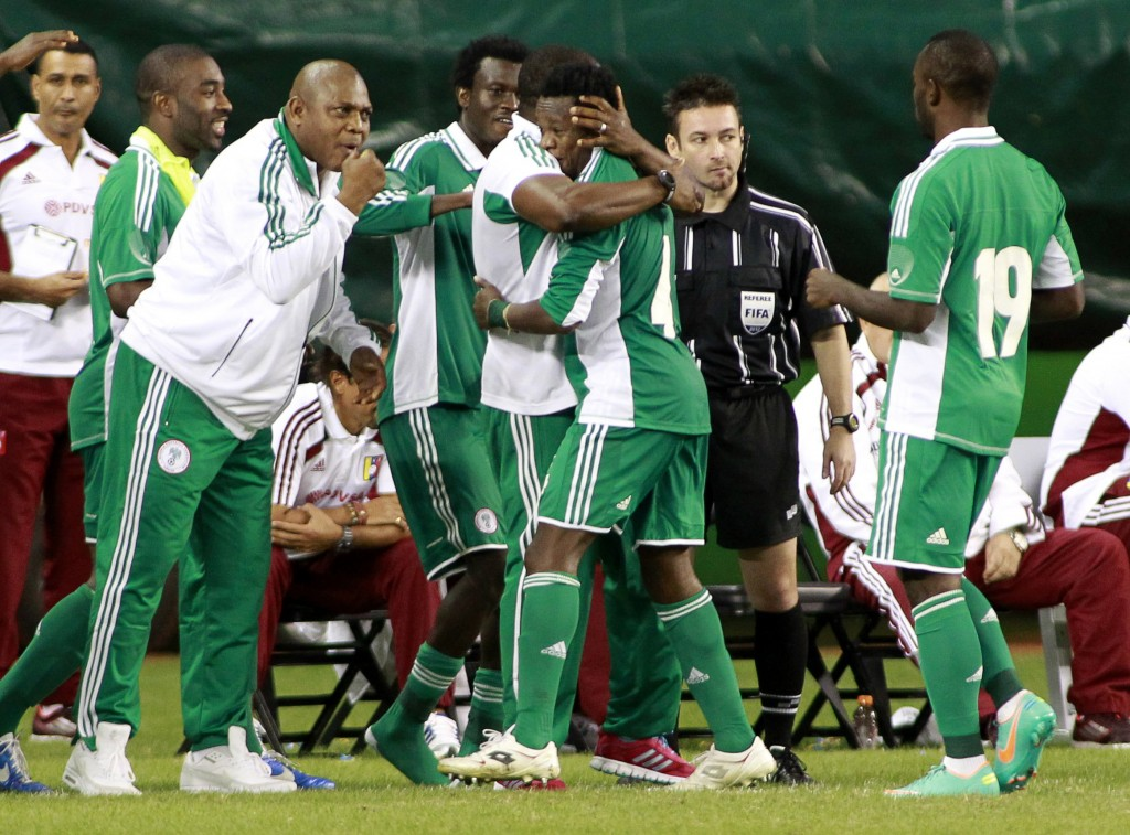 Nigeria's Onazi Ogenyi celebrates with teammates and coaches after his goal against Venezuela during their international friendly soccer match in Miami