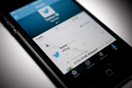 A Twitter Inc. tweet regarding the company ringing the opening bell on the New York Stock Exchange is displayed on an Apple iPhone. Bloomberg News