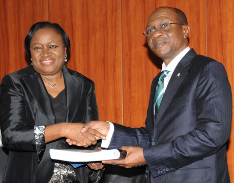 NEW CBN GOVERNOR, MR GODWIN EMEFIELE (R),  RECEIVING A HAND OVER NOTE FROM THE  ACTING GOVERNOR,   DR SARAH ALADE  IN ABUJA ON TUESDAY (3/6/14). 3502/3/6/2014/ICE/JAU/AIN/NAN