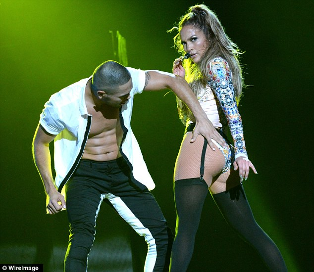 One of her male dancers even gave her pert posterior a cheeky grab at one stage during her energetic performance