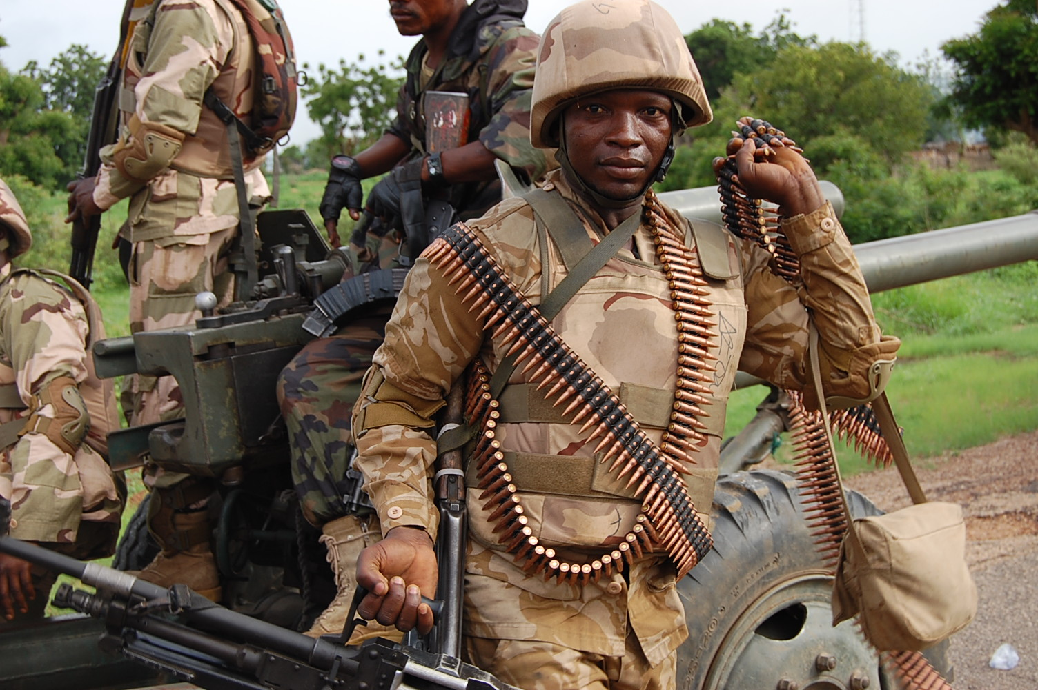 A soldier handling GPMG and its ammunition for the recapture of Damboa